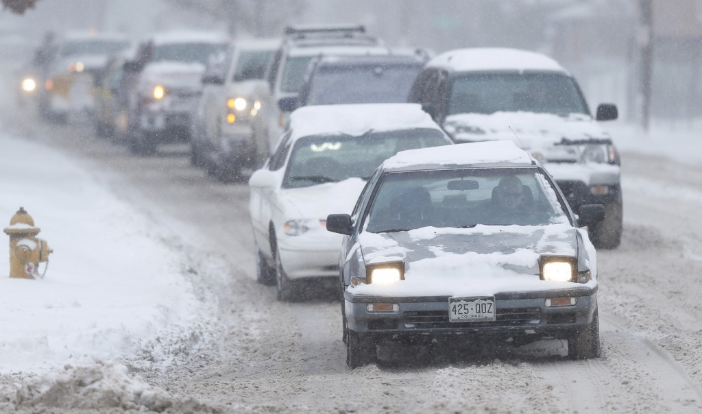 Motorists in Denver last week had to deal with a snowstorm, but in the New York, the winter solictutice with high temperatures in the 60's. (AP Photo/David Zalubowski)