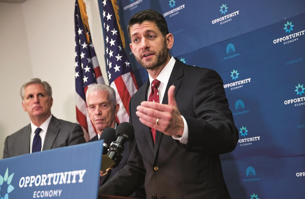 House Speaker Paul Ryan of Wis. (R) joined by Majority Leader Kevin McCarthy of Calif. (L) and Rep. Bill Johnson (C), R-Ohio, a member of the House Energy and Commerce Committee, speaks with reporters following a GOP strategy session at the Capitol in Washington, Tuesday. (AP Photo/J. Scott Applewhite)