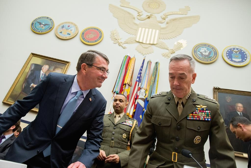 Defense Secretary Ash Carter (L) and Joint Chiefs Chairman Gen. Joseph Dunford Jr. arrive on Capitol Hill in Washington Tuesday to testify before the House Armed Services Committee hearing on the U.S. strategy for Syria and Iraq and its implications for the region. (AP Photo/Andrew Harnik)