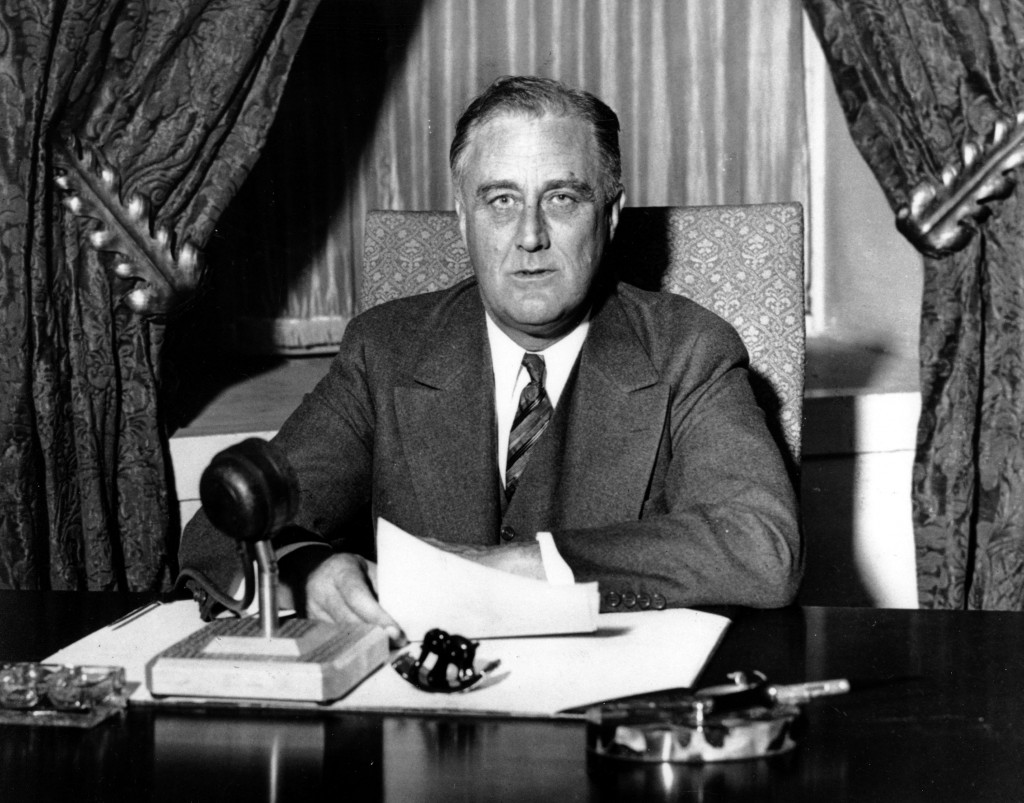President Franklin D. Roosevelt about to begin his historic fireside chat to the American people on March 12, 1933, explaining the measures he was taking to solidify the nation's shaky banking system. (AP Photo)