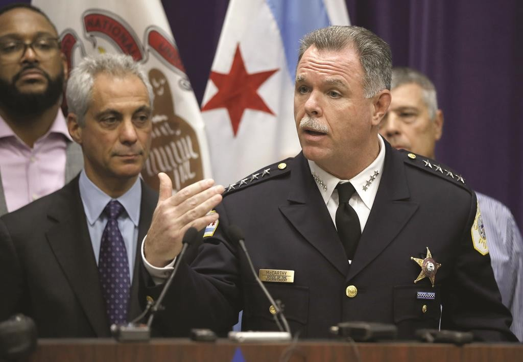 Chicago Police Superintendent Garry McCarthy (R) speaks on Nov. 24 about first-degree murder charges against police officer Jason Van Dyke in the death of 17-year-old Laquan McDonald, as Mayor Rahm Emanuel looks on at left.  (AP Photo/Charles Rex Arbogast, File)