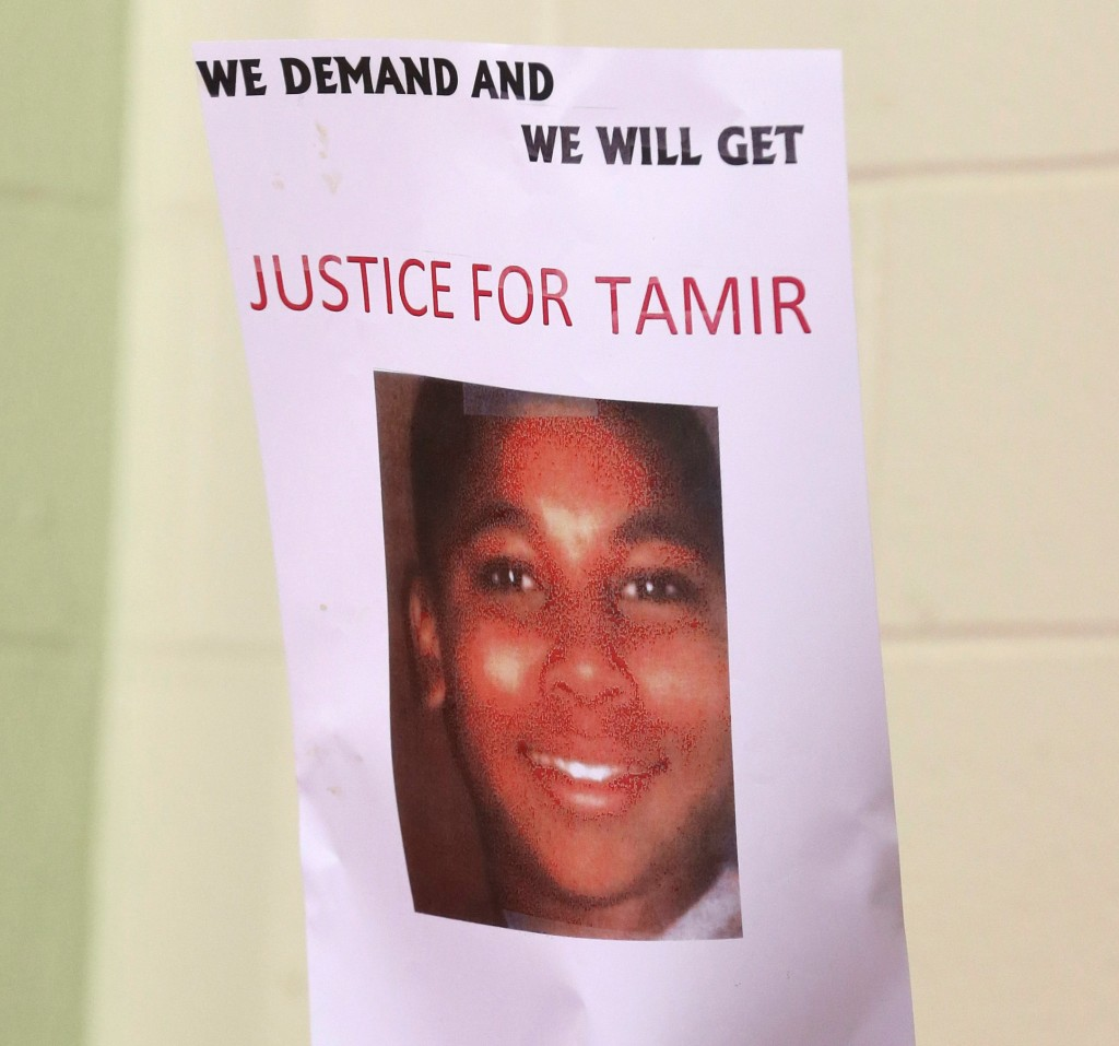 A Justice for Tamir sign is held up during a news conference in Cleveland on Dec. 8, 2014. On Dec. 28, 2015, a grand jusry declined to press charges against the rookie officer who sot and killed Rice. (AP Photo/Tony Dejak)
