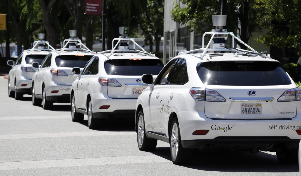 This 2014 photo shows a row of Google self-driving Lexus cars. (AP Photo/Eric Risberg, File)