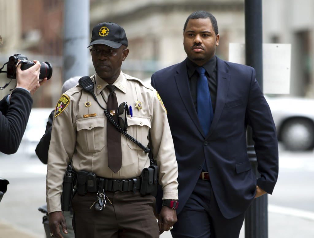 Officer William Porter, right, arriving at a courthouse during jury deliberations on Dec. 16. (AP Photo/Jose Luis Magana)