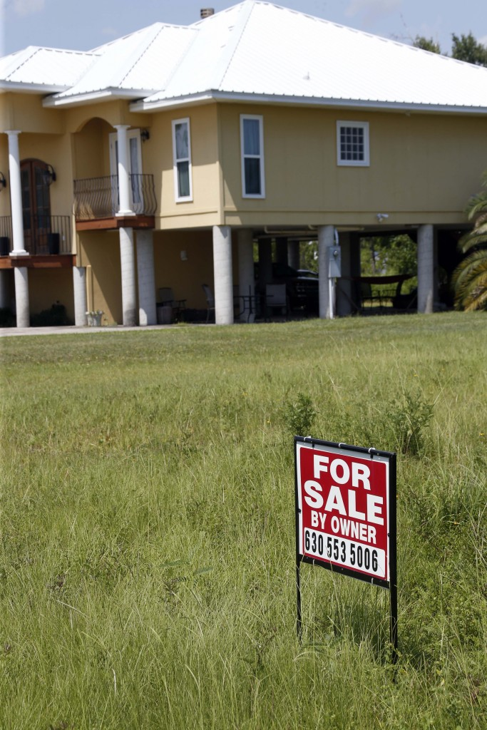 A home for sale last summer in Long Beach, Miss. (AP Photo/Rogelio V. Solis)