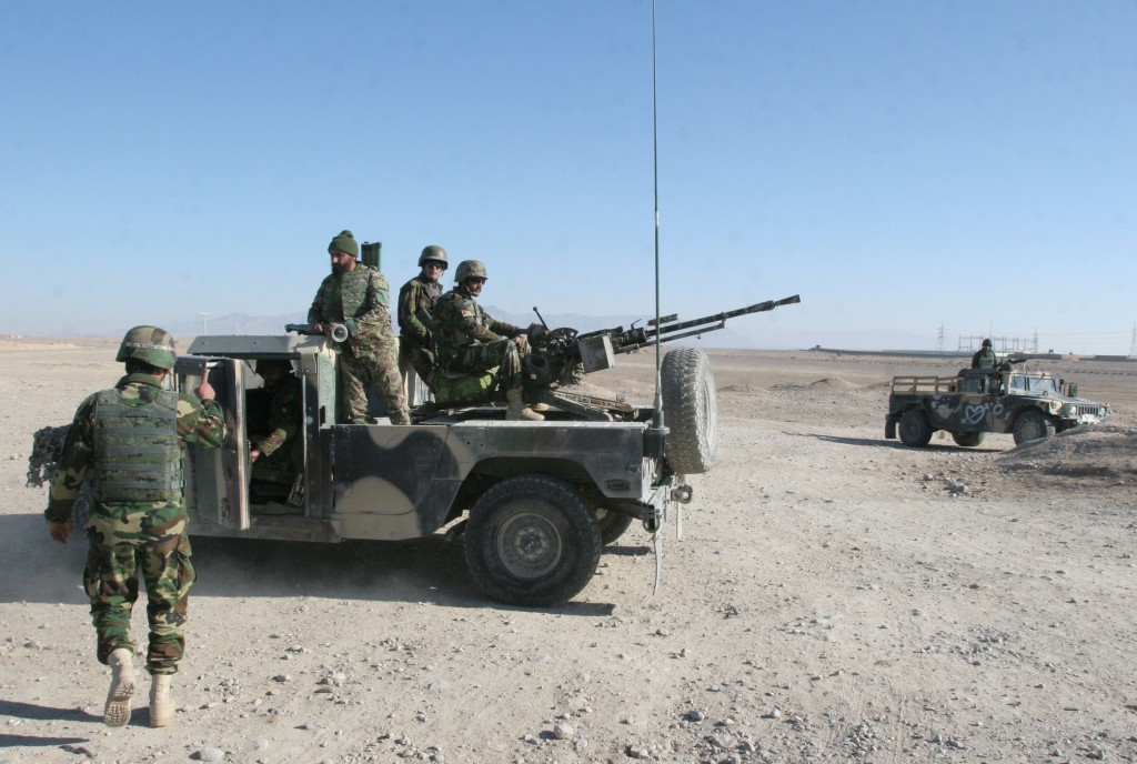 Afghan National Army soldiers guard a checkpoint on the way to the Sangin district of Helmand province, Afghanistan, on Wednesday.  (AP Photos/Abdul Khaliq)
