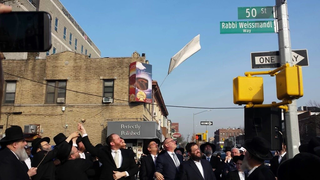 """Askanim and community leaders at a ceremony Sunday morning marking the renaming of 50th Street between 10th and 20th Avenues """"Rabbi Weissmandl Way,"""" in honor of Reb Michoel Ber Weissmandl, hero of hatzalah, whose rescue efforts prevented or delayed the deaths of untiold numbers of Jews. (Office of Councilman David Greenfield)"""