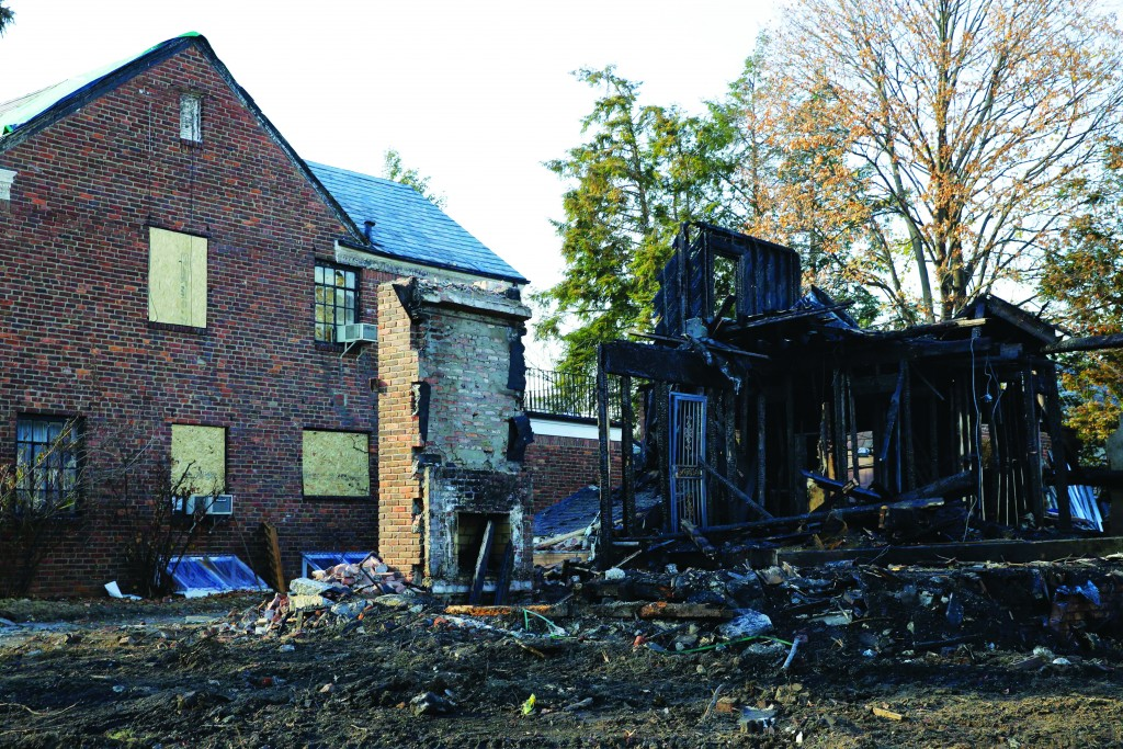 The remains of a construction site destroyed by arson is seen in the Forest Hills section of Queens in New York, Monday, Dec. 7, 2015. Over the past six weeks, an arsonist has torched six buildings in the same tight-knit section of eastern Queens, police say. Police aren't sure whether the victims are being targeted for their religion, their architectural taste, or for no reason at all. (AP Photo/Seth Wenig)