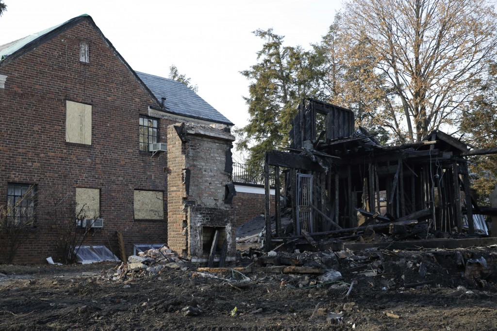 The remains of a construction site destroyed by arson in Forest Hills. (AP Photo/Seth Wenig)