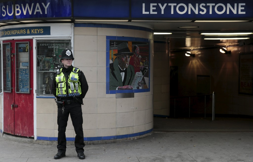 """A police officer patrols outside Leytonstone Underground station in east London, Britain December 6, 2015. A man wielding a knife slashed a man in the east London metro station on Saturday, reportedly screaming """"this is for Syria,"""" before police used a stun gun to subdue him in what they described as a terrorist incident. REUTERS/Suzanne Plunkett TPX IMAGES OF THE DAY"""