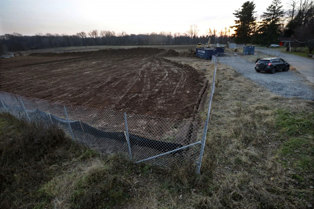 Removal of a tree line has taken place as preparations are made for the construction of new housing at the Institute of Advanced Study in Princeton, N.J. (AP Photo/Mel Evans)