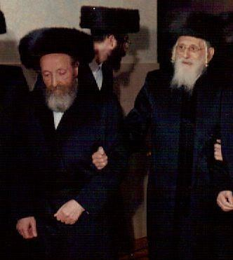 "Reb Moshe Blum, z""l, (left) with his mechutan, the Bobover Rebbe, zt""l, holding his arm, at a grandson's chasunah. (Blum family)"