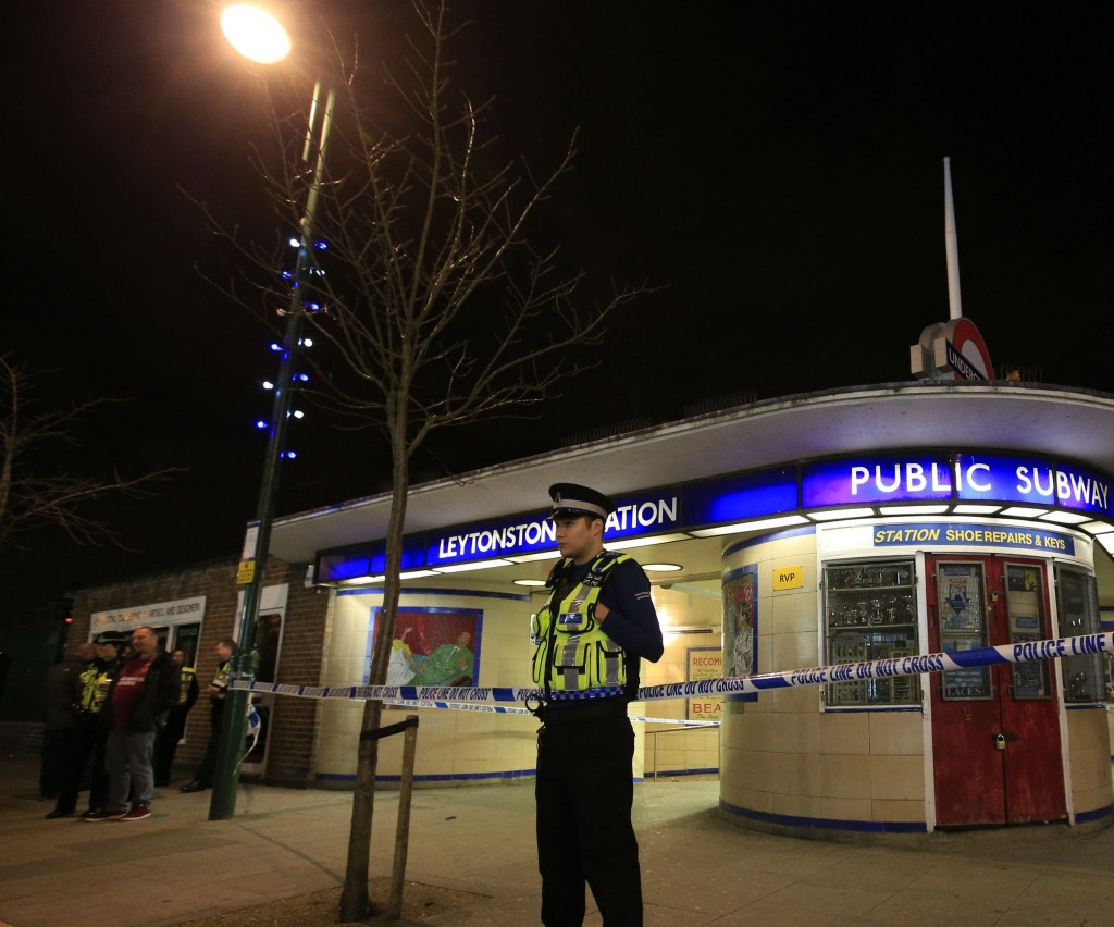 """Police cordon off Leytonstone Underground Station in east London following a stabbing incident, Saturday Dec. 5, 2015. The stabbing is being treated as a """"terrorist incident,"""" the London police said Saturday. The London police counterterror command said in a statement that it is investigating the incident in which a man was threatening people with a knife at around 7 p.m. (1900 GMT; 2 p.m. EST). One person sustained serious injuries and two others received minor injuries. (Jonathan Brady/PA via AP) UNITED KINGDOM OUT NO SALES NO ARCHIVE"""