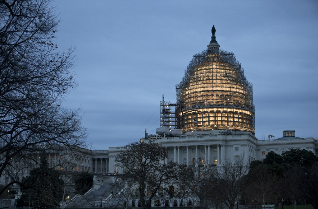 The Capitol Dome is illuminated amid scaffolding for repairs on Friday morning. (AP Photo/J. Scott Applewhite)