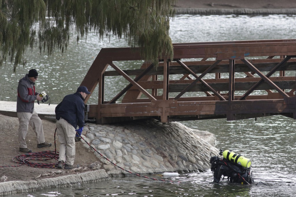 An FBI diver searches the water at Seccombe Lake Park after a shooting earlier this month in San Bernardino, California December 11, 2015. REUTERS/Jonathan Alcorn
