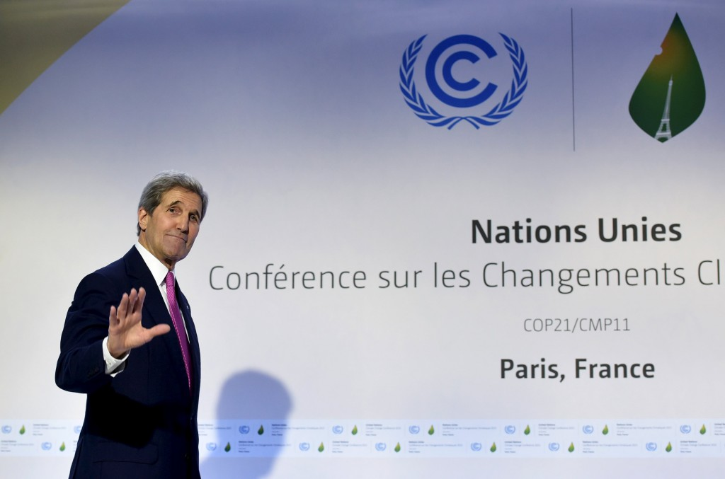 U.S. Secretary of State John Kerry waves after delivering a speech during the COP 21 United Nations conference on climate change at Le Bourget, on the outskirts of Paris, December 9, 2015. EUTERS/Mandel Ngan/Pool