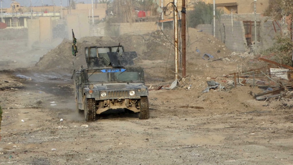 An Iraqi military vehicle drives in the city of Ramadi, December 27, 2015. Picture taken December 27, 2015. REUTERS/Stringer FOR EDITORIAL USE ONLY. NO RESALES. NO ARCHIVE.