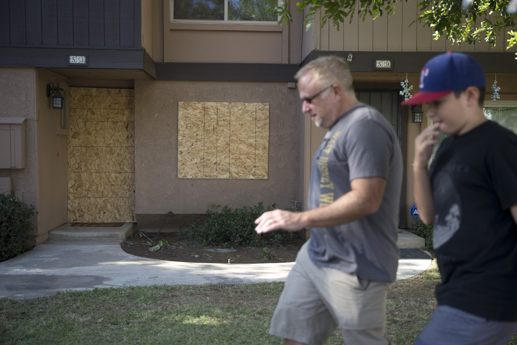 The townhouse rented by San Bernardino shooting rampage suspects Syed Farook and his wife, Tashfeen Malik, is boarded up, Saturday, Dec. 5, 2015, in Redlands, Calif. (AP Photo/Jae C. Hong)