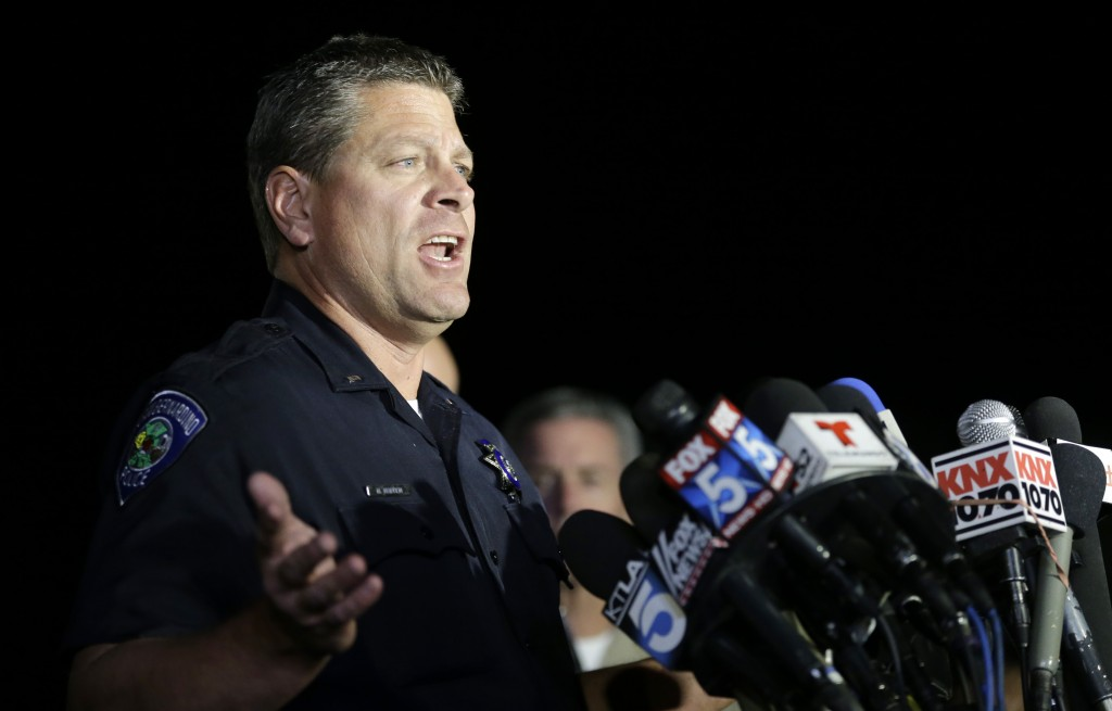 San Bernardino Police Lt. Mike Madden, who was one one of the first officers on the scene, describes his experience during a press conference near the site of the San Bernardino shooting. (AP Photo/Chris Carlson)