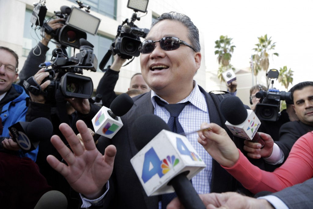 Young Kim, defense attorney for Enrique Marquez, is questioned by reporters outside federal court after a hearing at in Riverside, Calif. on Monday, Dec. 21, 2015. Marquez, who bought the assault rifles his friend used in the San Bernardino massacre, will remain in custody as he faces terrorism-related allegations because he is a danger to the community, a judge ruled Monday. (AP Photo/Nick Ut)