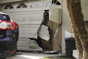 A garage door of Enrique Marquez's home is seen broken in a recent FBI raid, in Riverside, Calif. (AP Photo/Jae C. Hong)