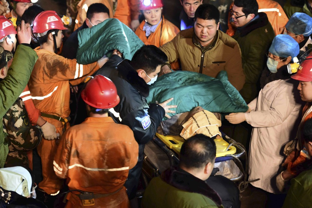 In this Dec. 25 photo released by China's Xinhua News Agency, a trapped miner is rescued from a collapsed gypsum mine in Pingyi County, east China's Shandong Province. (Guo Xulei/Xinhua via AP)