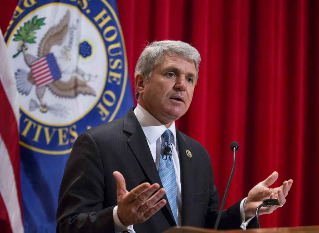 "House Homeland Security Committee Chairman Mike McCaul, R-Texas, delivers a ""State of Homeland Security"" address on the war with Islamic State, the rise of radicalism, and the terror threat to the U.S., at the National War College at Fort McNair, in Washington, Monday, Dec. 7, 2015. McCaul wants to create a national commission on security and technology to deal with the proliferation of encrypted technologies that allow terrorists to communicate without detection. (AP Photo/J. Scott Applewhite)"