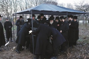 Davening at the two new matzeivos in the beis hachaim in Zelechow, Poland. (JDN)