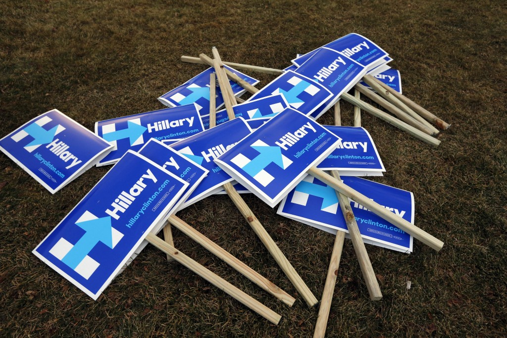 Hillary Clinton campaign signs lie in a pile outside the debate hall before a Democratic presidential primary debate Saturday, Dec. 19, 2015, at Saint Anselm College in Manchester, N.H. (AP Photo/Michael Dwyer)