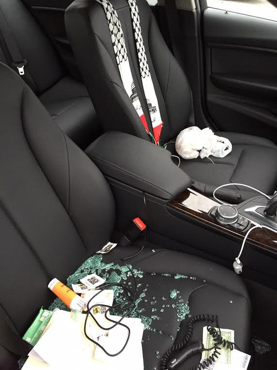 One of the vandalized cars. Note that items in the car, including cash, were untouched by the vandals. (Office of Assemblyman Dov Hikind)