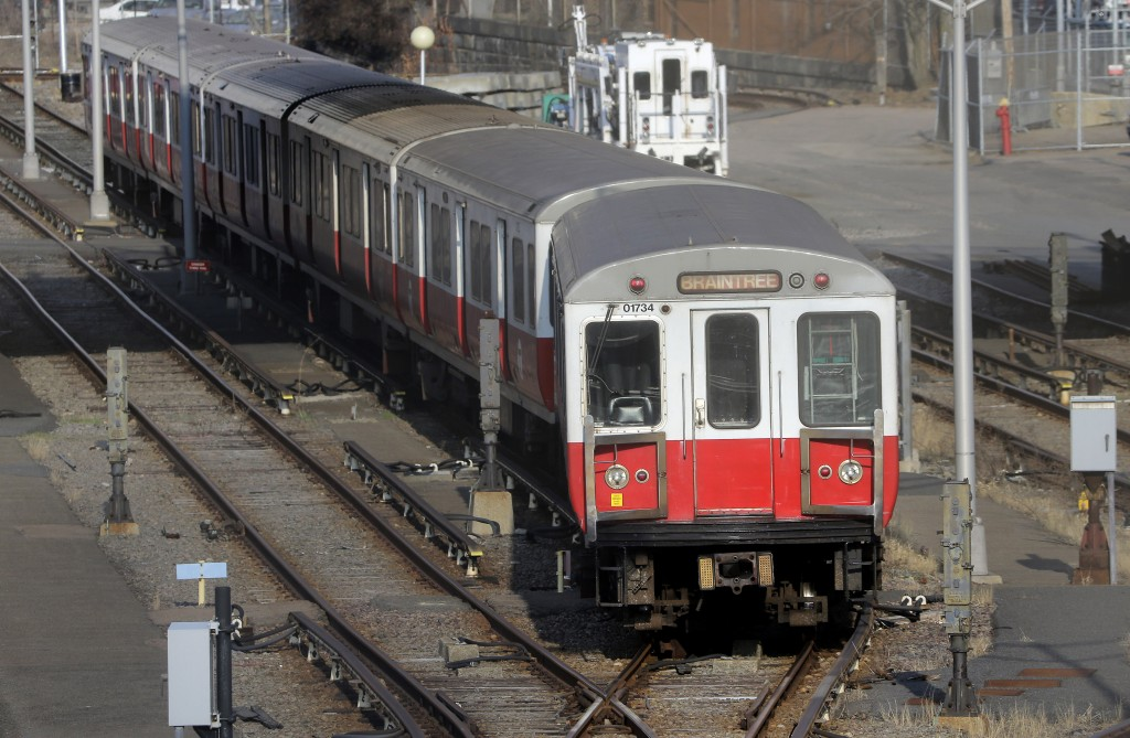 A passenger train moves slowly along tracks in a railway yard, on Thursday, in Boston. The six-car train with passengers on board left a suburban Boston transit station without a driver Thursday and went through four stations without stopping. (AP Photo/Steven Senne)
