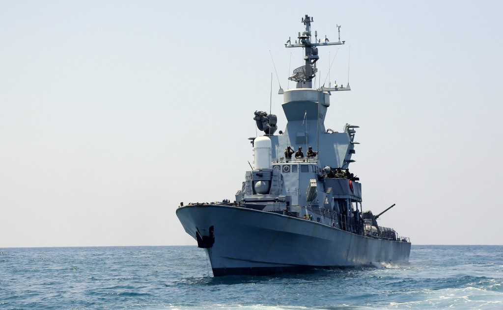 "Israeli Navy soldiers seen on IDF (Israel Defense Force) ships, off the coast of Gaza, during Operation ""Protective Edge"" on July 28, 2014. The operation entered its 22nd day today, with 10 Israeli soldiers having been killed in a Hamas tunnel attack, and in a mortar attack which hit in the Southern Israeli Eshkol region yesterday. Gazan health officials put the death toll there at over 1,000, and Israel states hundreds of those killed are Hamas fighters. Israeli Prime Minister Benjamin Netanyahu said that the Gaza operation would go on until the tunnel threat was stopped. Photo by Edi Israel/FLASH90"