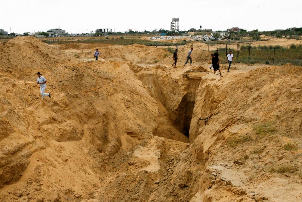 Palestinian men looks at what used to be a tunnel leading from the Gaza Strip into Israel, in the area of Rafah in the southern Gaza Strip, on August 5, 2014, after a 72-hour truce agreed by Israel and the ruling Hamas movement went into effect following intense global pressure to end the bloody conflict. The firing finally stopped after 29 days of bitter and bloody fighting, bringing relief to millions on both sides of the border and halting the soaring death toll in Gaza where at least 1,867 people have died. Photo by Abed Rahim Khatib/Flash90