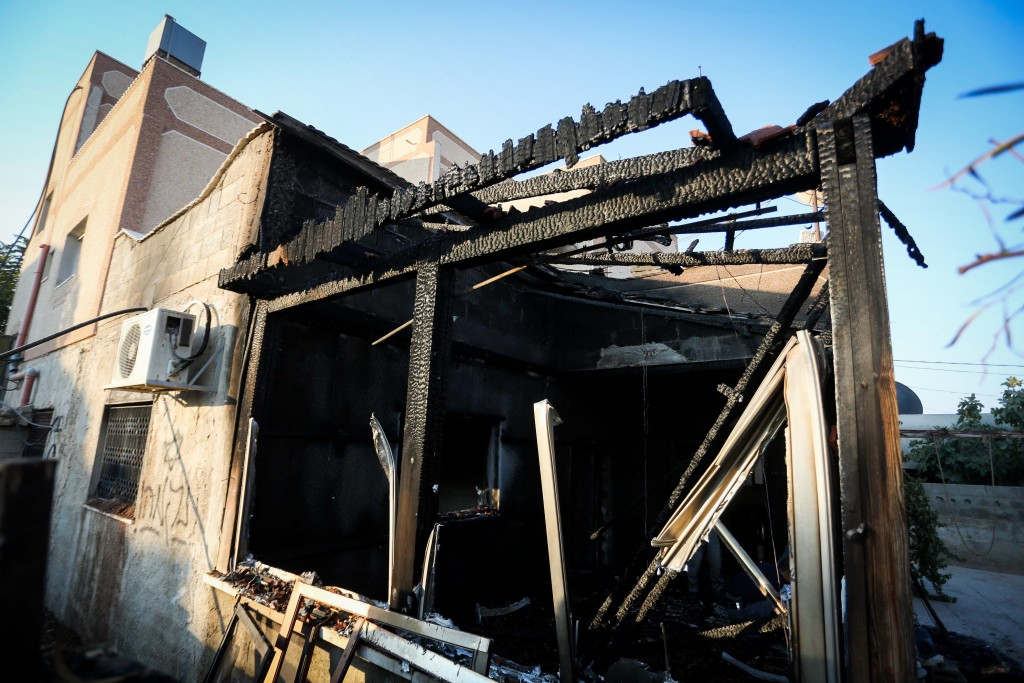 "The scene of a house in the Palestinian village of Duma, near Nablus, where a Palestinian infant was killed earlier this morning, July 31, 2015, in an arson attack, apparently by Jewish extremists. Two homes in Duma, were set on fire, and the Hebrew words ""revenge"" and ""long live king messiah"" were spray-painted on their walls, alongside a Star of David. Photo by FLASH90"
