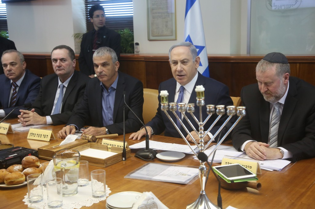 Israeli Prime Minister Benjamin Netanyahu leads the weekly government conference, with the Hanukkia on tha table marking the first night of the Jewish holiday of Hanukkah, at PM Netanyahu's office in Jerusalem, on December 6, 2015. Photo by Emil Salman/Haaretz