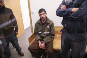 Raed Khalil, 36, arrives to a court hearing at the District Court in Tel Aviv on December 13, 2015. Raed Khalil is suspected of carrying a terror attack last month at the Panorama office building at an entrance to a room used for prayer services next to the parking lot as afternoon prayers were taking place. The Palestinian terrorist, two people murdered at the terror attack. Photo by Flash90 *** Local Caption ***