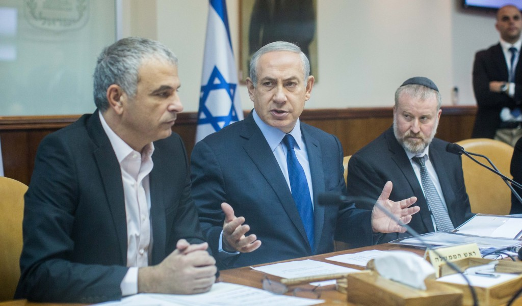 Israeli Prime Minister Benjamin Netanyahu (C) leads the weekly government conference, at Prime Minister's Office in Jerusalem, on December 13, 2015. Photo by Yonatan Sindel/Flash90