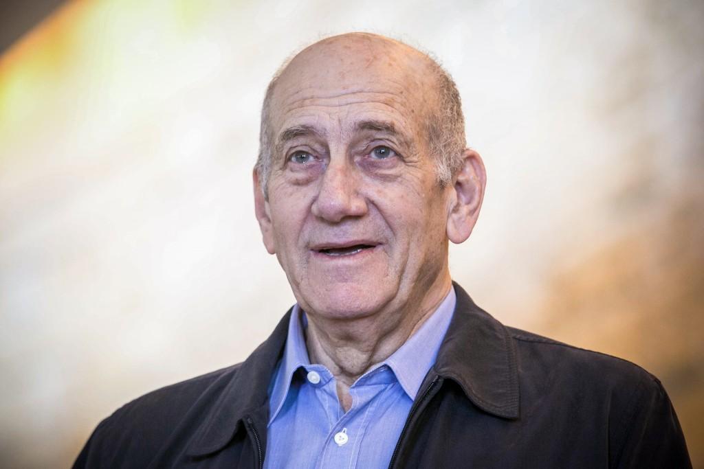 Former Prime Minister Ehud Olmert speaks to press at the Jerusalem Supreme Court on December 29, 2015. Photo by Noam Moskowitz/POOL