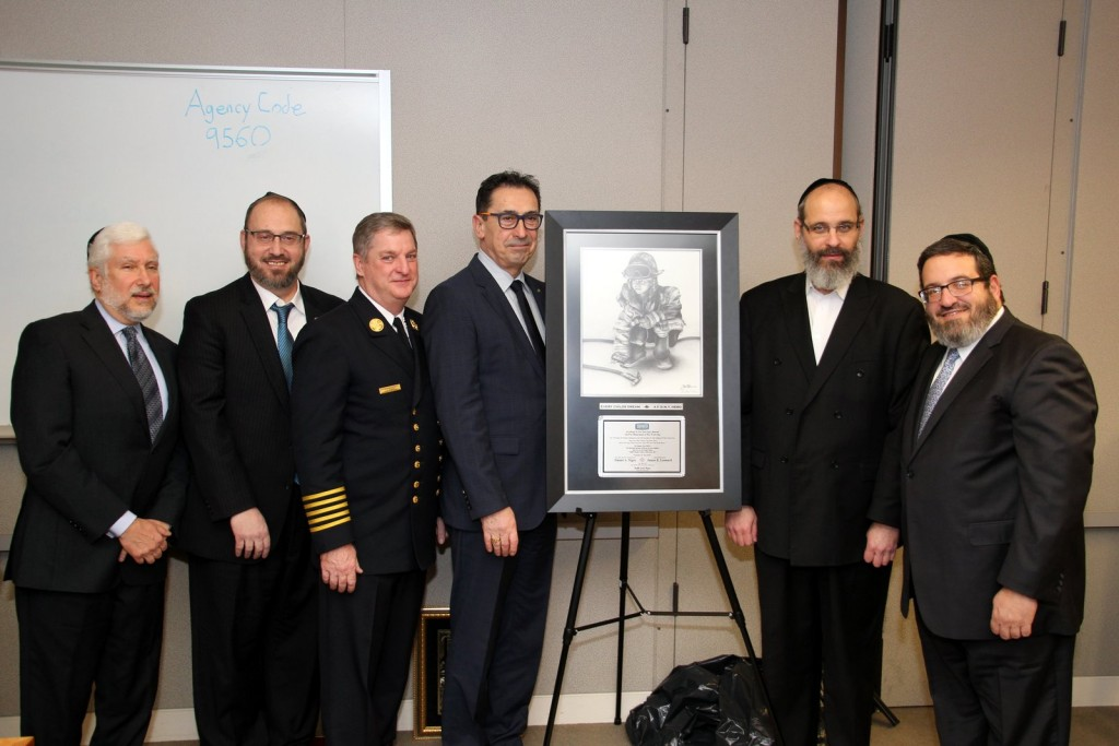 Yanky Meyer of Misaskim (right of plaque) presents Fire Commissioner Daniel Nigro (left of plaque) with an award thanking FDNY for 150 years of saving lives. (Hillel Engel/Misaskim)