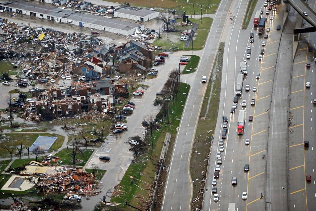 Morning News via AP Traffic backs up along I-30, right near a site of Saturday's tornado in Garland, Texas, on Sunday. (G.J. McCarthy/The Dallas Morning News via AP)