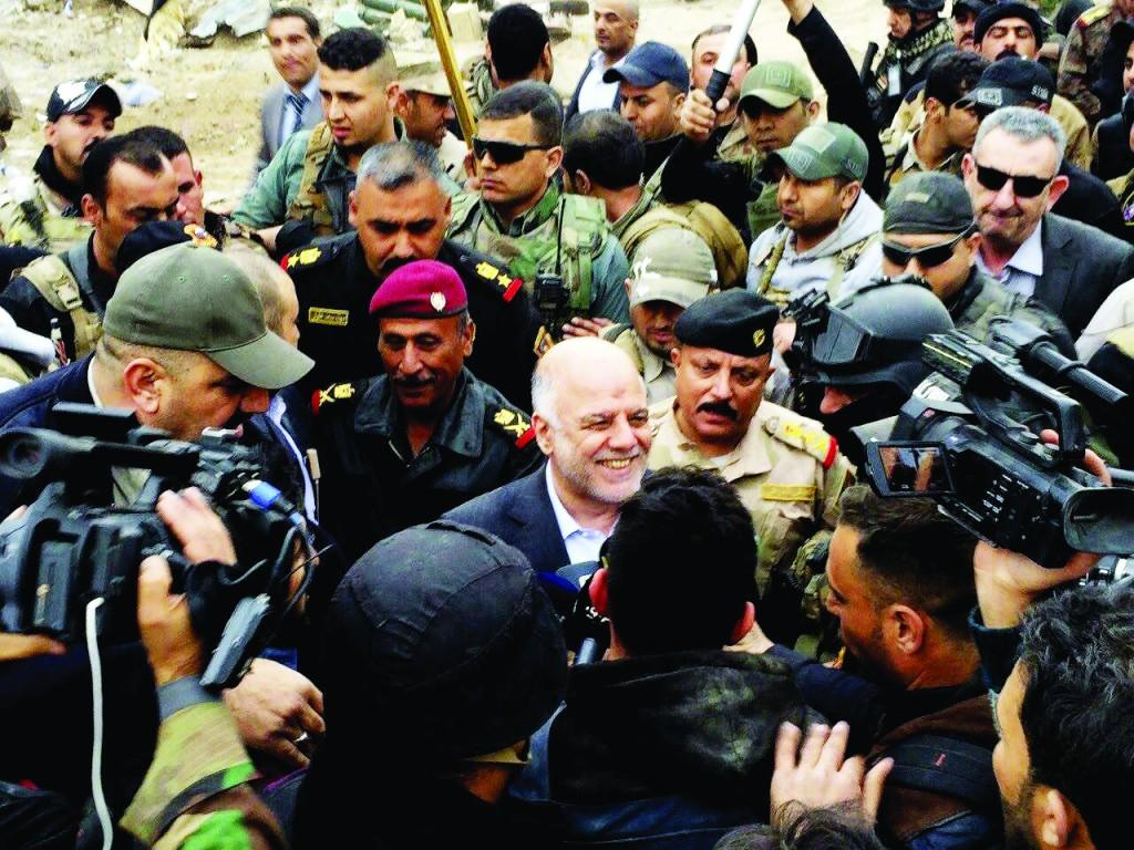 Iraqi Prime Minister Haider al-Abadi tours the city of Ramadi Tuesday. (AP Photo)