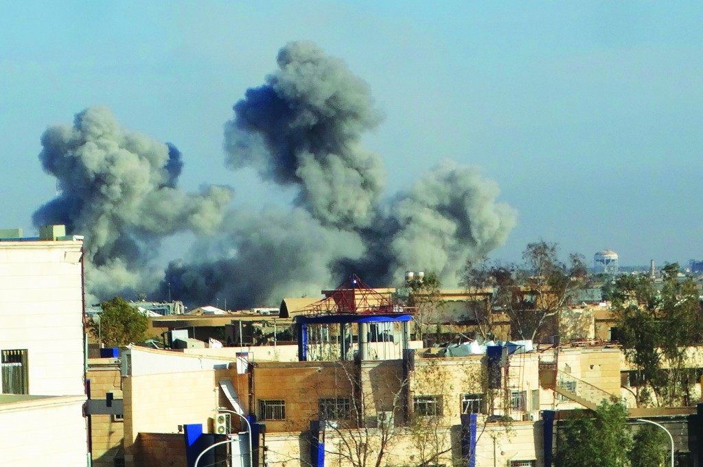 Smoke rises from Islamic State positions following a U.S.-led coalition airstrike in Ramadi, the capital of Iraq's Anbar province, 70 miles west of Baghdad, Iraq, on Wednesday. (AP Photo/Osama Sami)