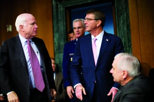 Defense Secretary Ash Carter, (C), followed by Joint Chiefs Vice Chairman Gen. Paul Selva, is greeted on Capitol Hill by Senate Armed Services Committee Chairman Sen. John McCain (R-Ariz.) (L) and the committee's ranking member Jack Reed (D-R.I.) (R), prior to testifying before the committee's hearing on Wednesday.  (AP Photo/Pablo)