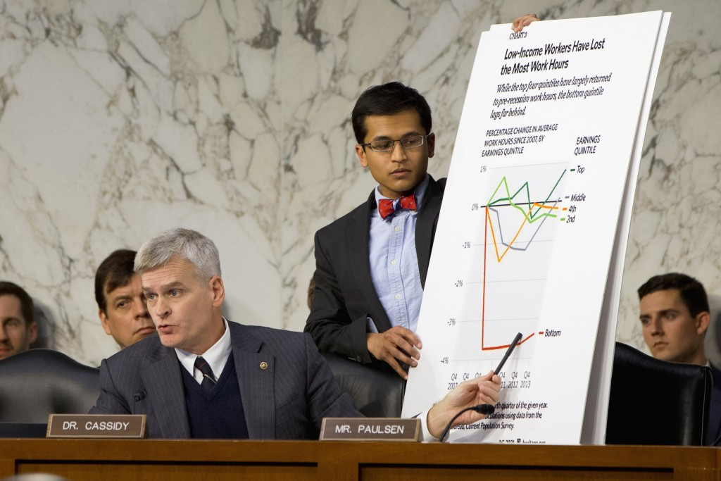 Joint Economic Committee member Sen. Bill Cassidy, R-La., points to a chart on low-income workers as he questions Federal Reserve Chair Janet Yellen during the committee's hearing on Capitol Hill on Thursday. (AP Photo/Jacquelyn Martin)