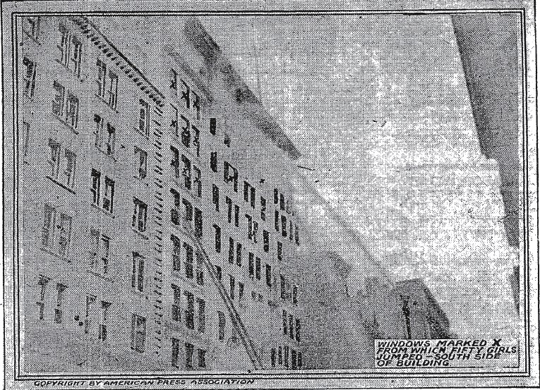 A picture taken hours after the 1911 fire showing the windows where 50 garment workers jumped out of windows. (Wikipedia)