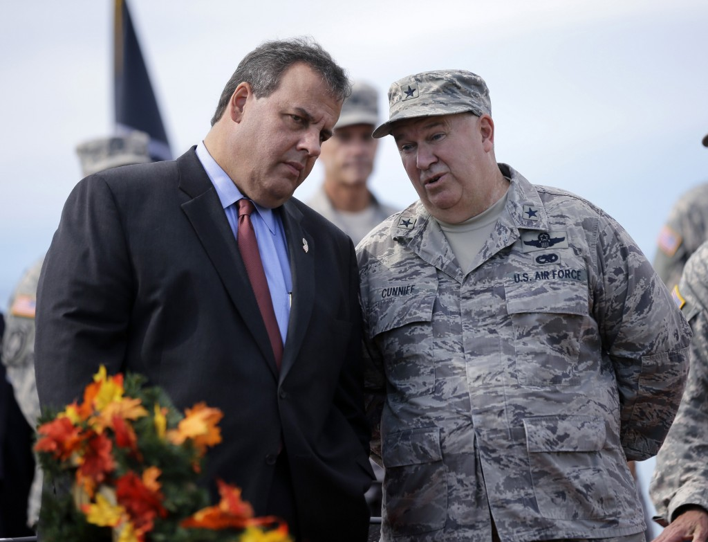 New Jersey Gov. Chris Christie, left, listens to New Jersey Adjutant General Brig. Gen. Michael Cunniff in 2014 during a military review in Sea Girt, N.J. (AP Photo/Mel Evans, File)