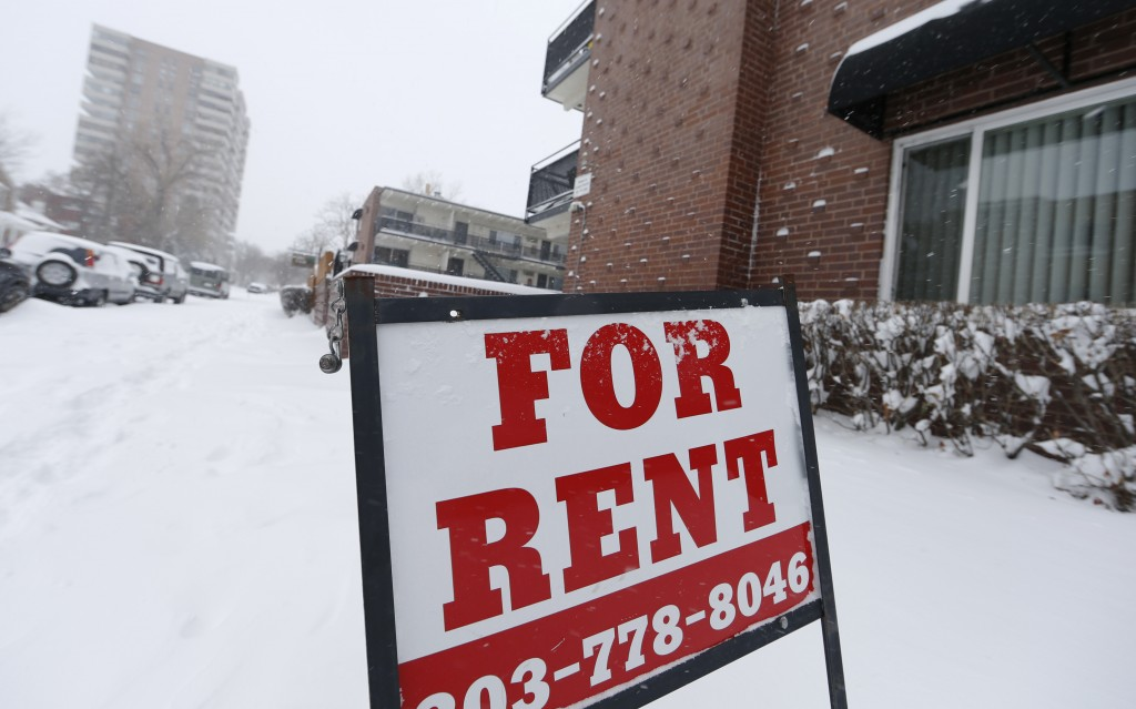 In this Tuesday, Dec. 15, 2015, photograph, a sign indicates a vacancy in a rental housing unit near downtown Denver. (AP Photo/David Zalubowski)