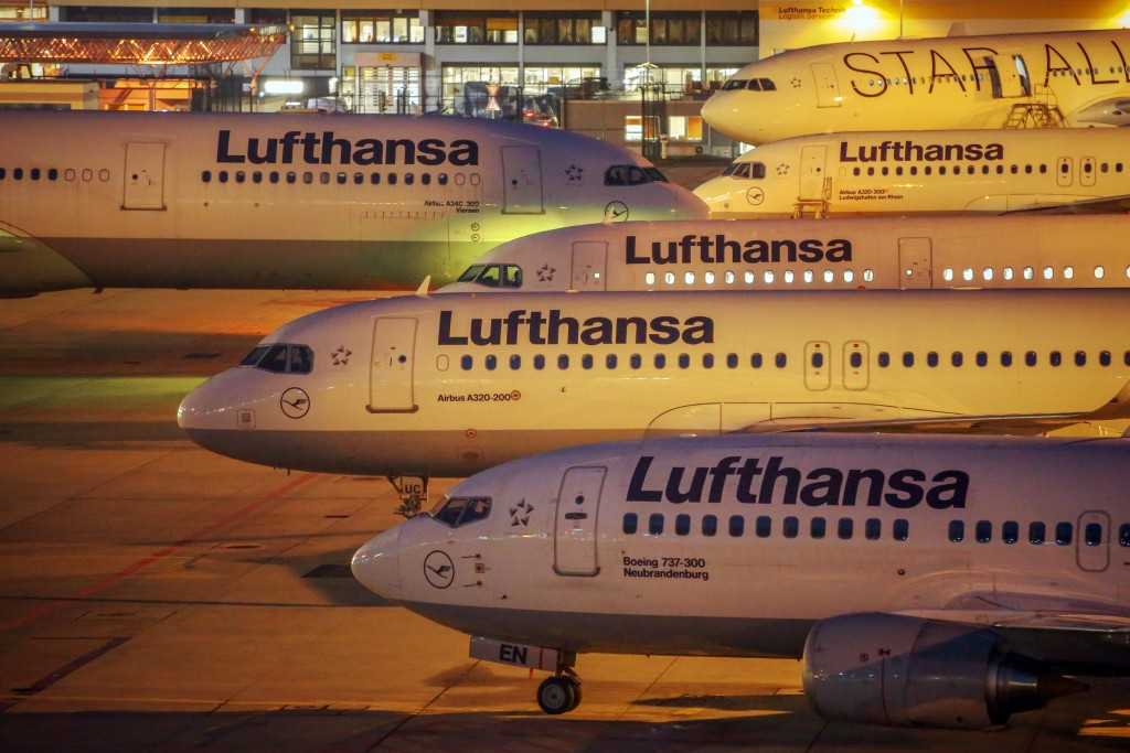 Lufthansa planes on the tarmac of the Frankfurt airport. (Fredrik von Erichsen/dpa via AP)
