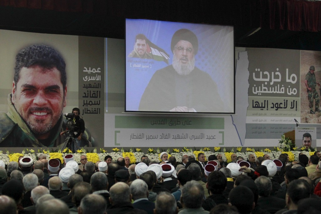 Lebanon's Hezbollah leader Sayyed Hassan Nasrallah addresses his supporters via a screen during a commemoration service marking one week since the killing of Hezbollah militant leader Samir Qantar, in Beirut's southern suburbs, December 27, 2015. Samir Qantar was killed in an Israeli air strike in Damascus. REUTERS/Aziz Taher