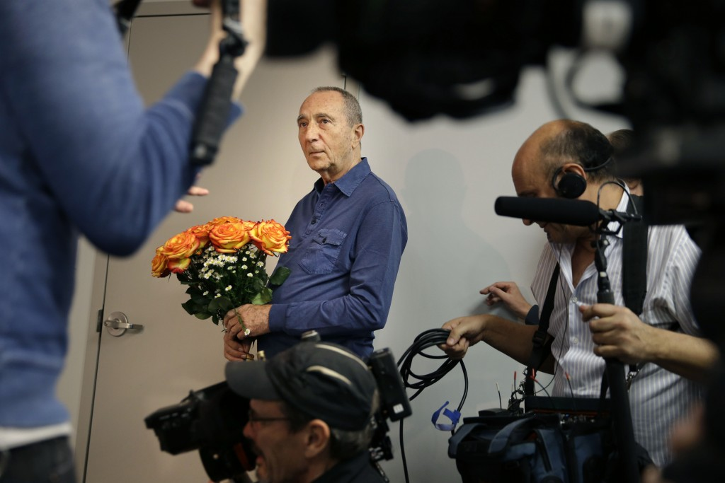 Michael Hochberg is surrounded by reporters Wednesday as he waits to reunite with Krystyna Jakubowski at Kennedy Airport. (AP Photo/Seth Wenig)